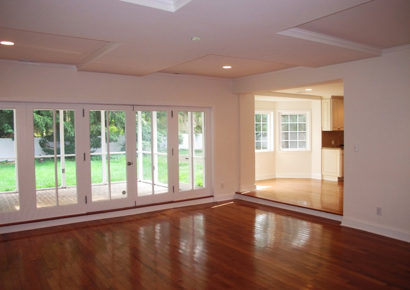Great Room With Coffered Ceiling Leads To The Screened In Porch