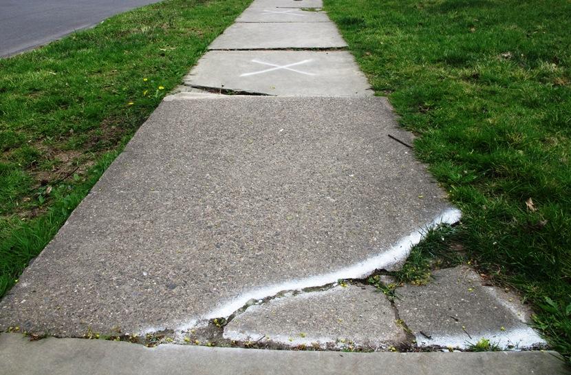Cracked Sidewalks Marked For Repair