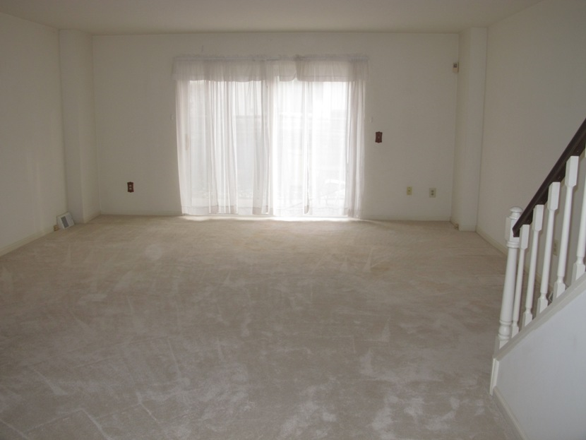 Living Room With Sliding Door To Patio